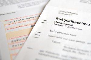 Anhörung im Bußgeldverfahren: Eine rote Ampel wurde überfahren? Ein Anwalt kann helfen.